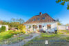 Mehrgenerationenhaus mit einer freien Wohnung 5km zum Ostseestrand - Frontansicht