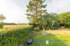 Einfamilienhaus ca. 145m² 5 Zimmer auf ca. 814m² Grundstück in 23749 Grube - Garten mit Rasenmährobotter